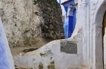 Fachadas y muro de piedra